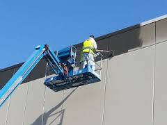 commercial painting in moline illinois by Shambaugh painting with the use of a JLG for safety reason